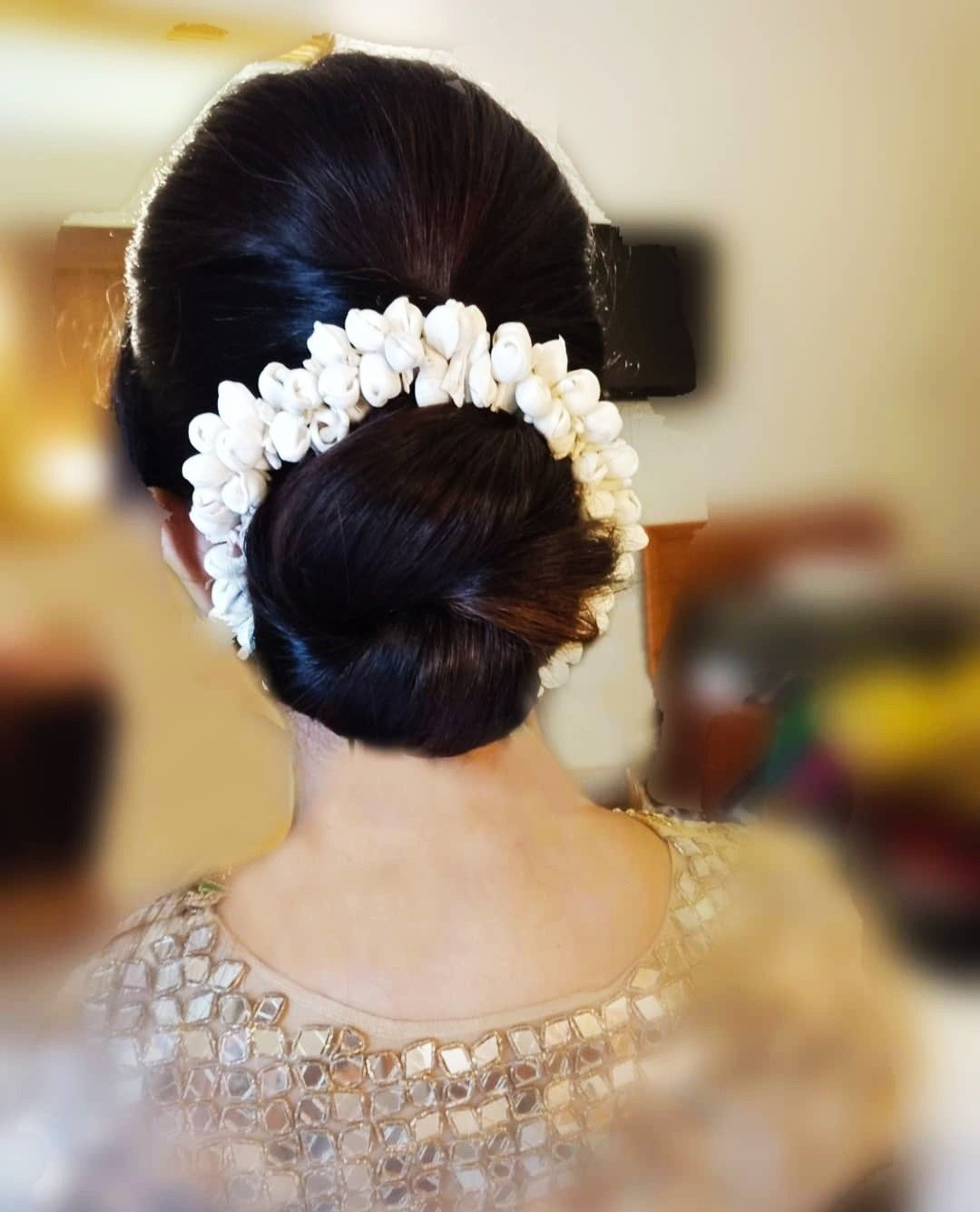 What A Beautiful Large Large Low Bun With Real Flower Gajra Care However Should Be Taken Before Adop Bridal Hair Buns Low Bun Hairstyles Indian Bun Hairstyles