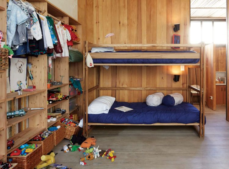 Great shared kids room- NET bunk beds, wall of wood storage shelves ...