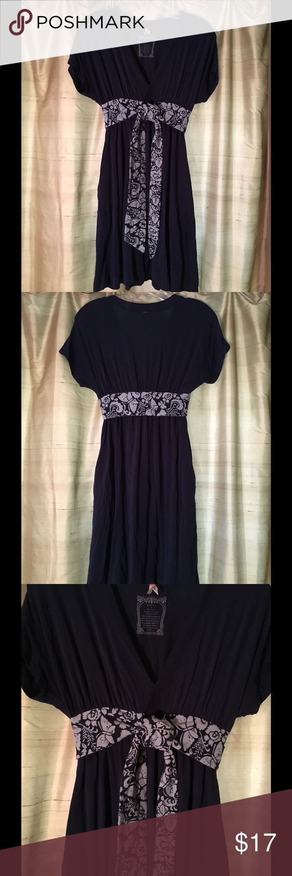 "Pinkerton navy dress Navy dress with ""scarf tie"" around midsection. Short sleeve and has pockets. 95% tencel 5% spandex.  Good condition Pinkerton Dresses"