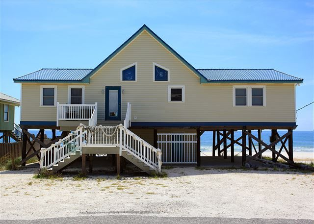 THE HOLE - This large, one level, older Gulf Front beach home features a split floor plan that has plenty of room for everyone! It has an open living area with cable t.v., a VCR, a stereo with cd player, a huge screened deck, two open decks, a fully equipped kitchen, 5 bedrooms and 3 baths. There are 2 Gulf front Master bedrooms with king size beds, a bunk room off of the kitchen with a twin over a full, a bedroom with 2 queen size beds, and a bedroom with 2 twin beds.