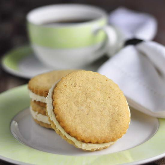 "Maple Walnut Sandwich Cookies - a couple of scrumptious, tender walnut shortbread cookies get sandwiched together with some indulgent maple buttercream frosting in a perfect flavor combination. Another ideal ""cuppa tea"" cookie."