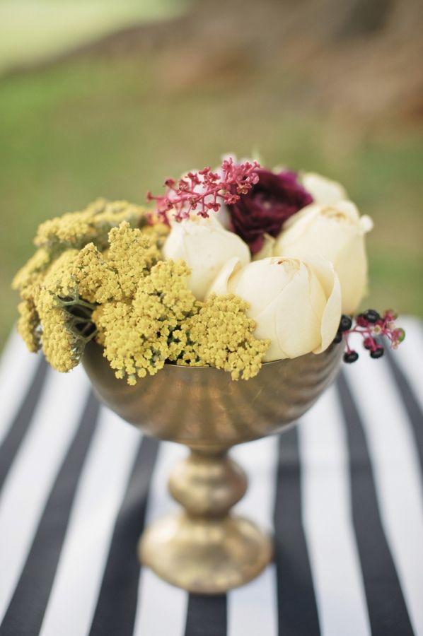 stemless flowers in vintage metal vases