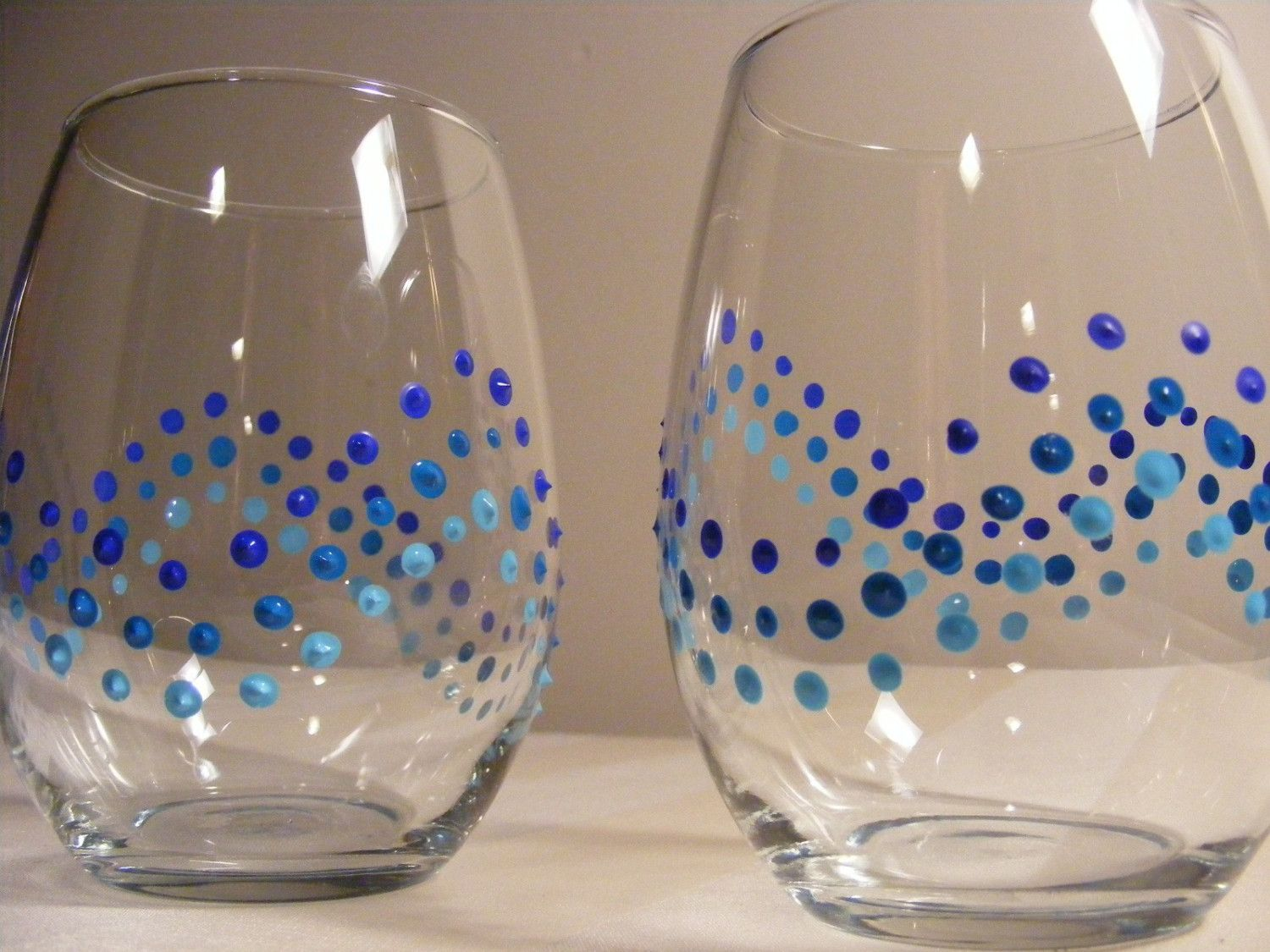 painted wine glasses with blue polka dots  - perfect for a beach wedding. $25.00, via Etsy.