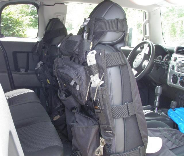 Tacticool seat covers. The placement of the knife would suggest that you really trust who ever is sitting behind you!