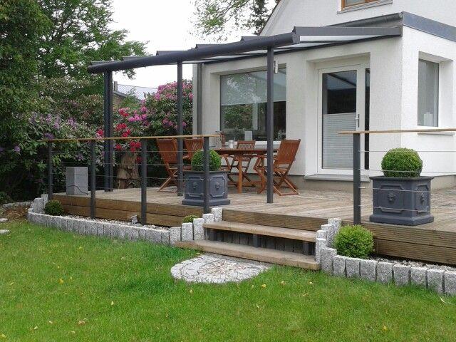Holzterrasse granitpalisaden alu terrassendach mit Gartengestaltung terrasse ideen