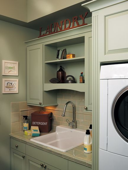 Thoughtful Design Of A Small Laundry Room, With The Stacked Washer/dryer,  Small
