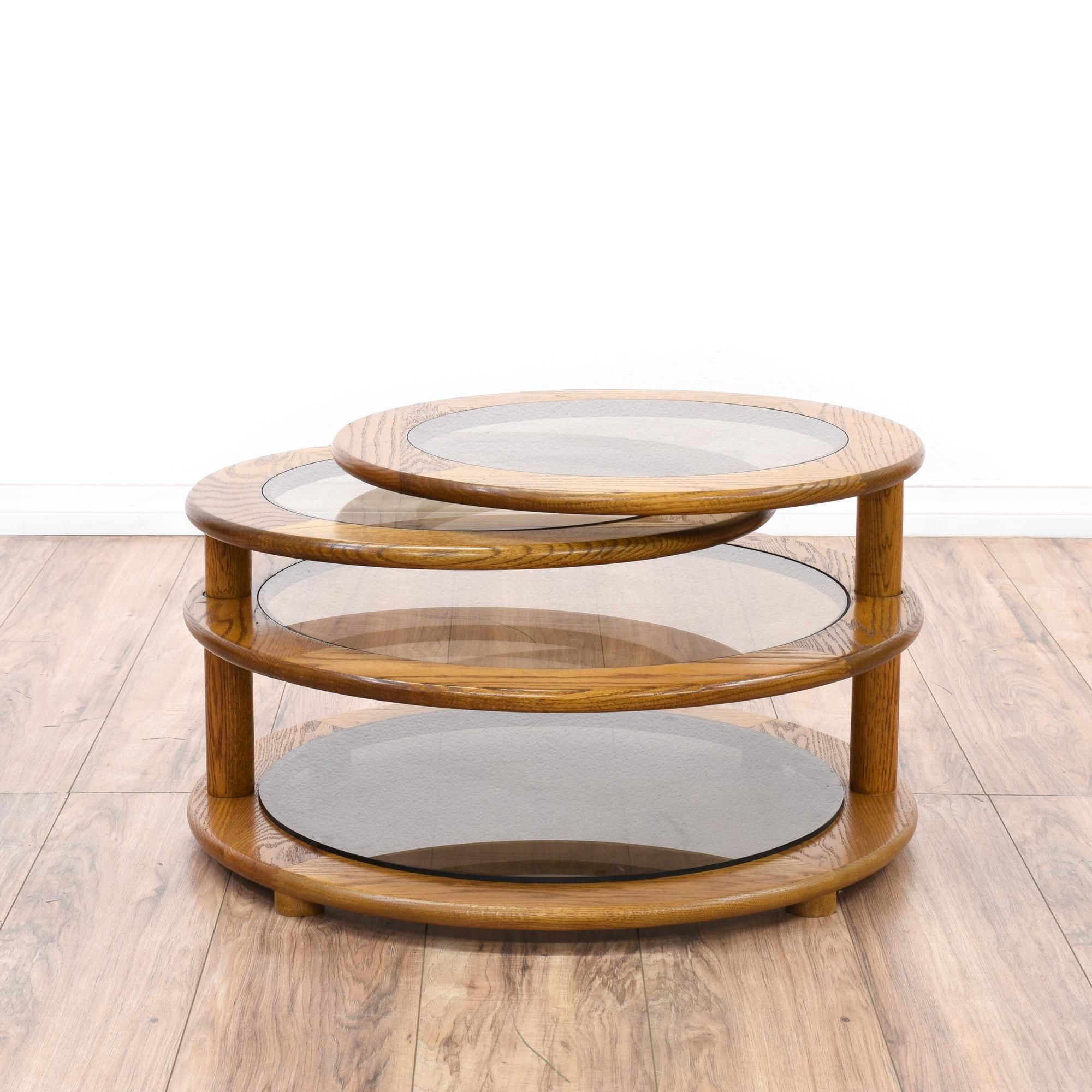 This Round Swivel Coffee Table Is Featured In A Solid Wood With Glossy Oak Finish