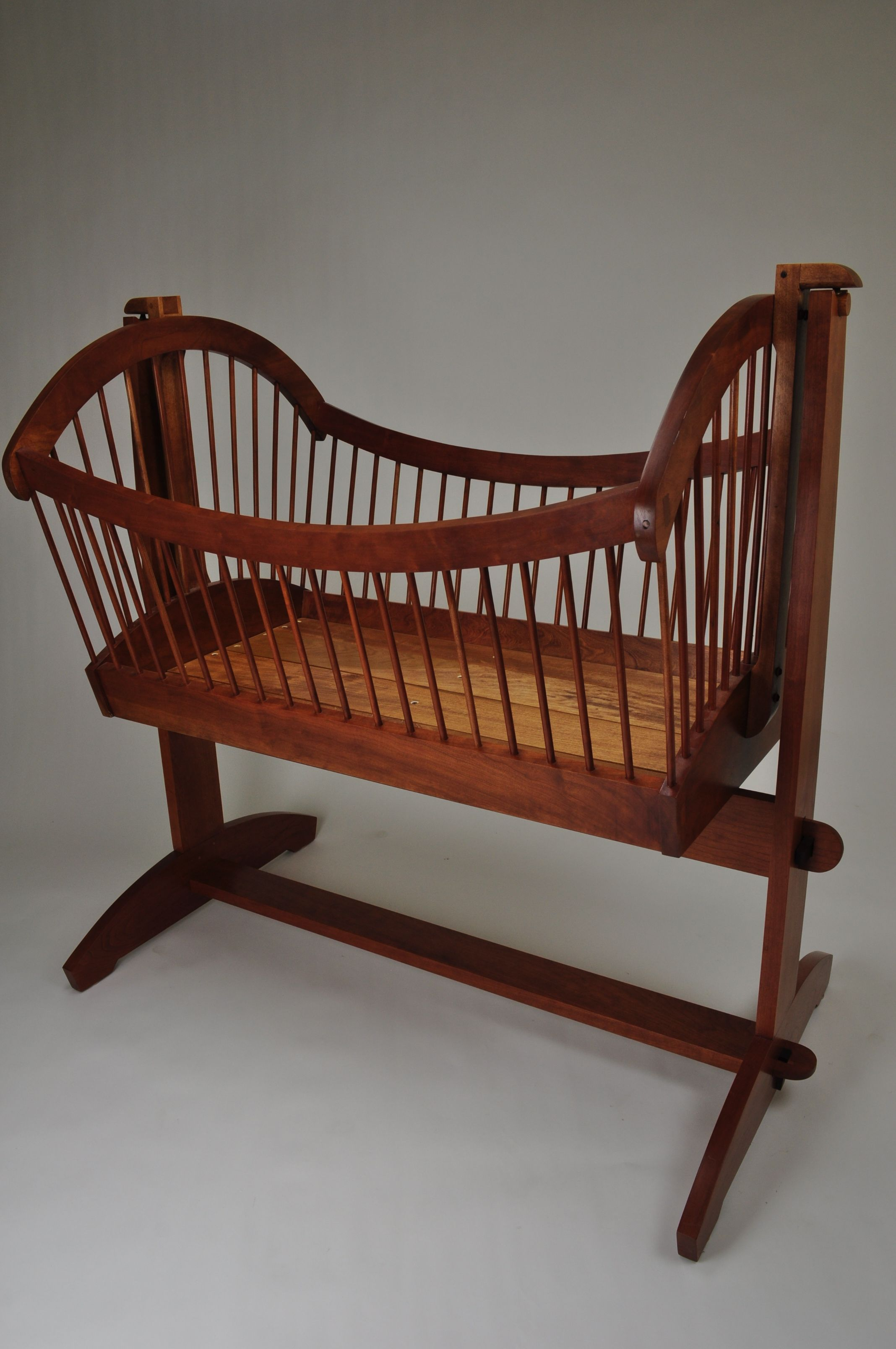 Baby cribs and cradles - Simple Wooden Baby Cradle With Natural Brown Color Scheme From The Wood Element And Small Spoke