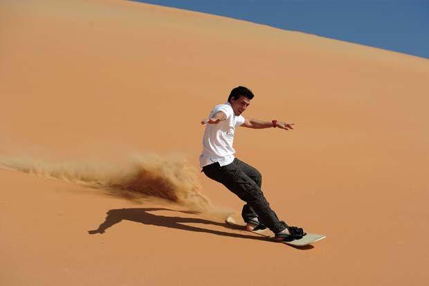 Sand Boarding Skiing In Abu Dhabi Visitabudhabi Ae Travel And Tourism Sandboarding Cool Places To Visit
