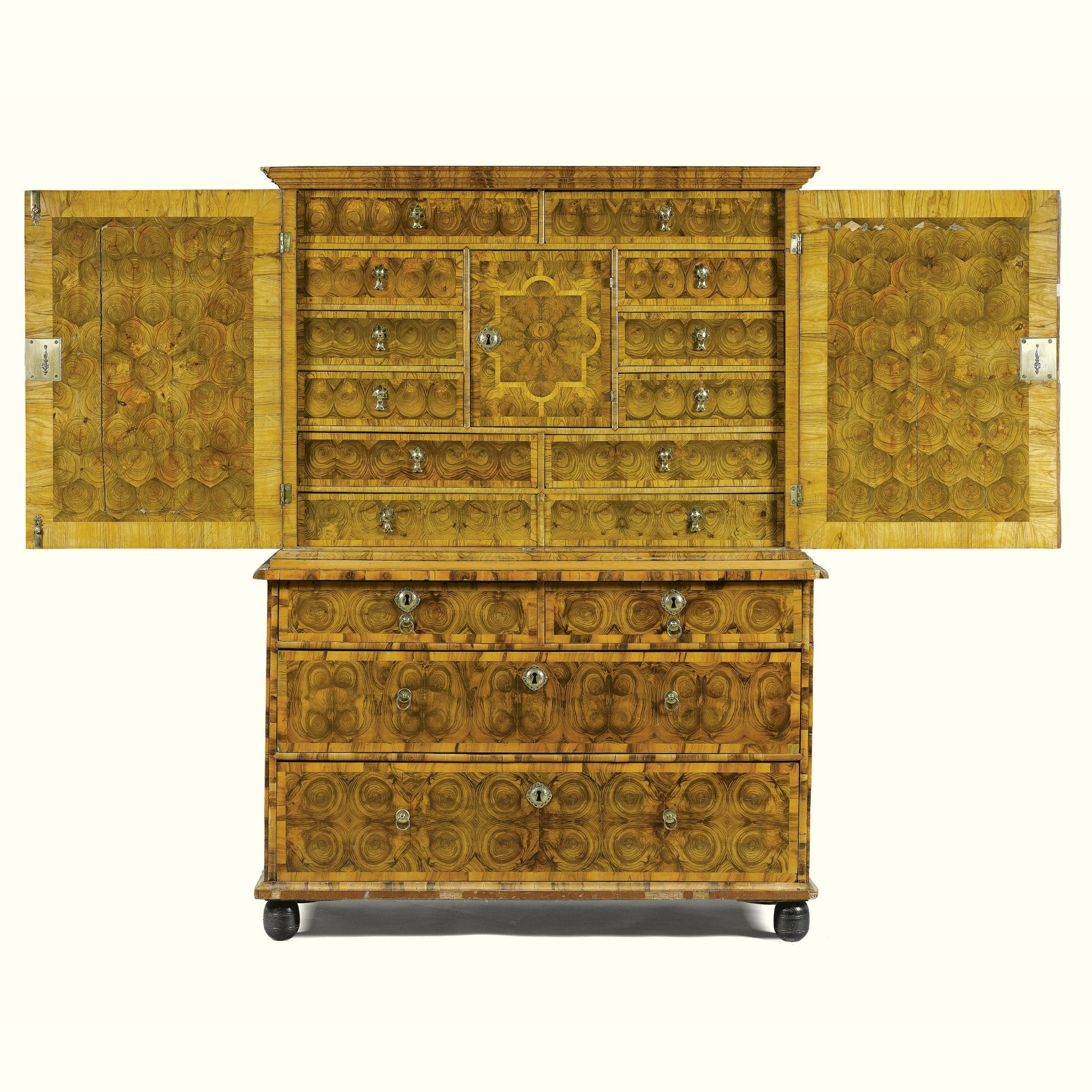 A William and Mary inlaid walnut cabinet on chest<br>circa 1695, attributed to Gerrit Jensen | lot | Sotheby's
