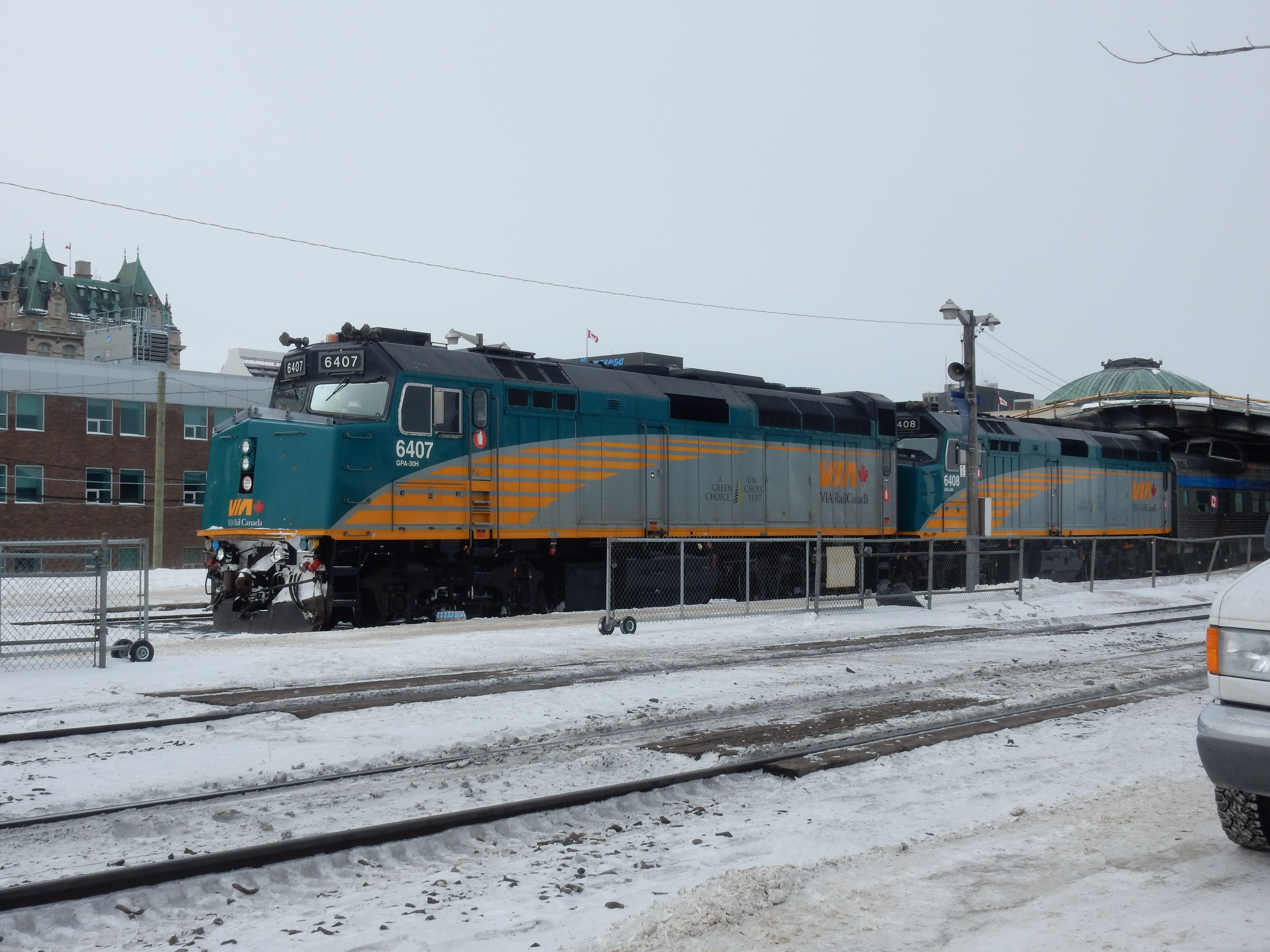 Train stopped at Winnipeg. Two parked outside