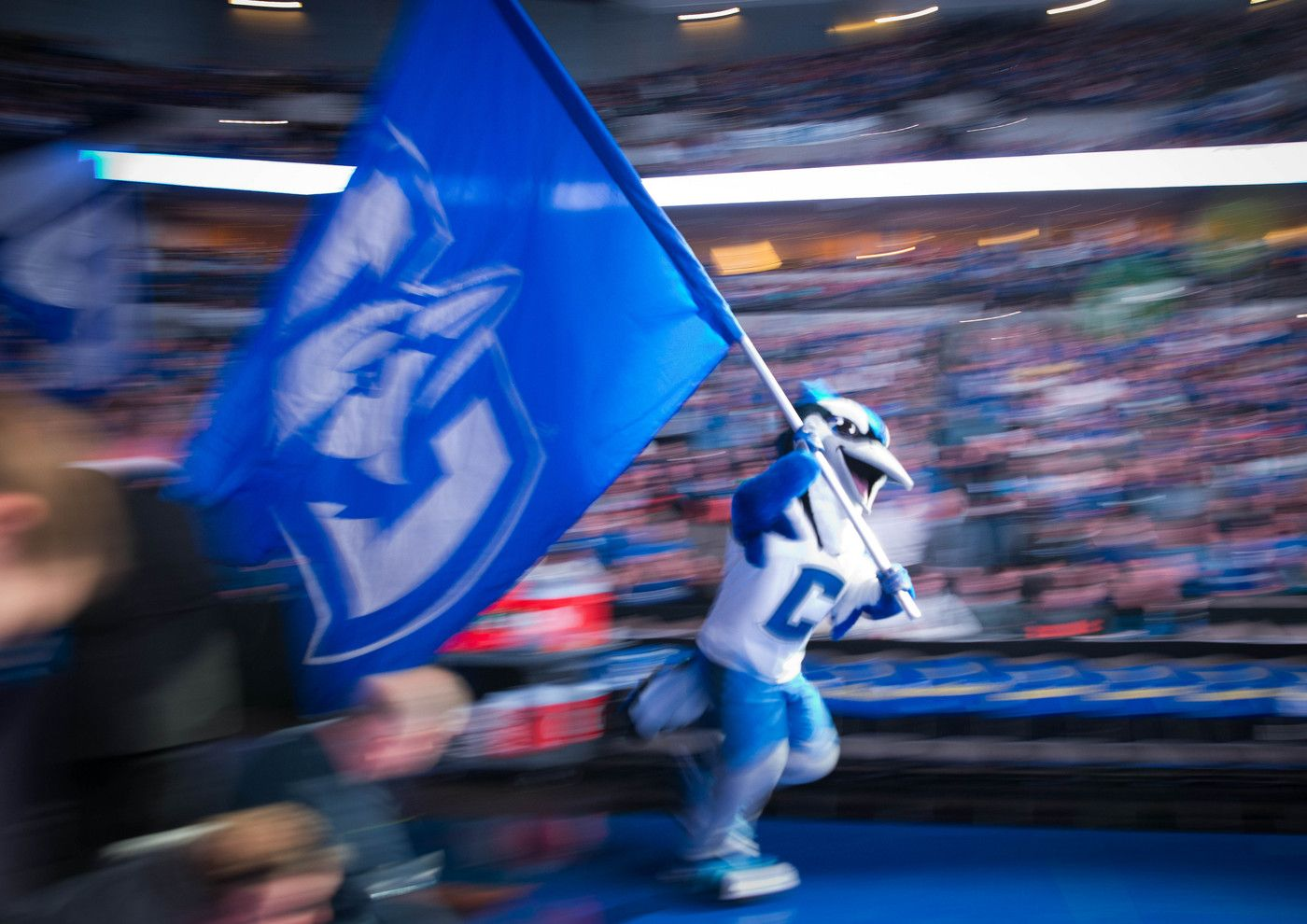 The Creighton mascot leads the team on to the court before
