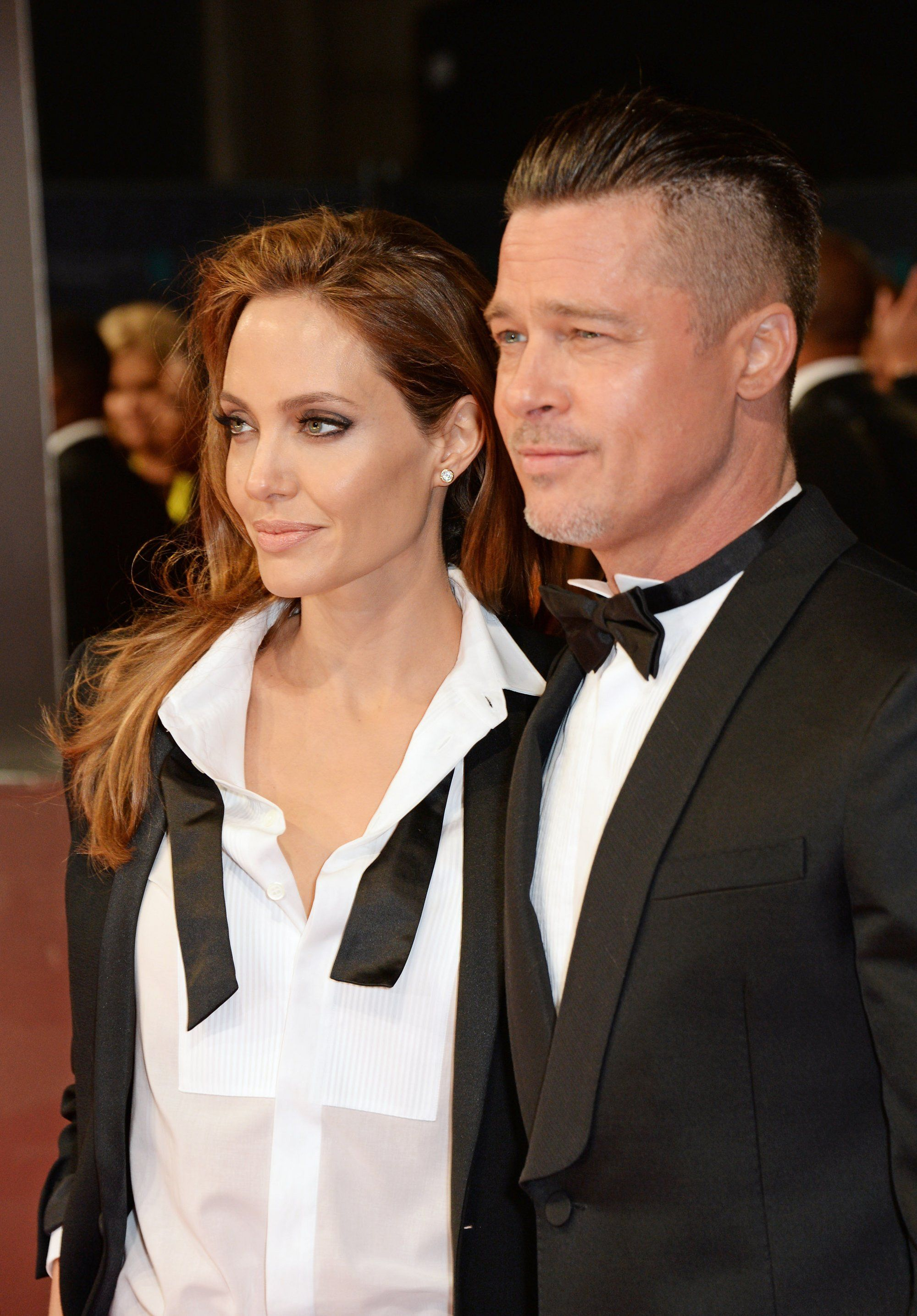 Angelina Jolie and Brad Pitt - They've been together for years and have six children together, but they only recently tied the knot, in 2014. (She wore an Atelier Versace dress that was embroidered with designs drawn by the kids.) Aside from their acting careers, Jolie and Pitt are on a mission to save the world through their involvement in an impressive array of charities.