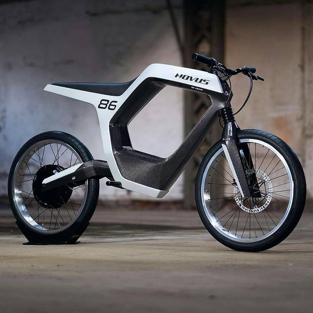 This Novus E Motorcycle Is Incredibly Designed This Stylish Frame Houses Battery Motor New Electric Bike Electric Bicycle Design Electric Bike Bicycles