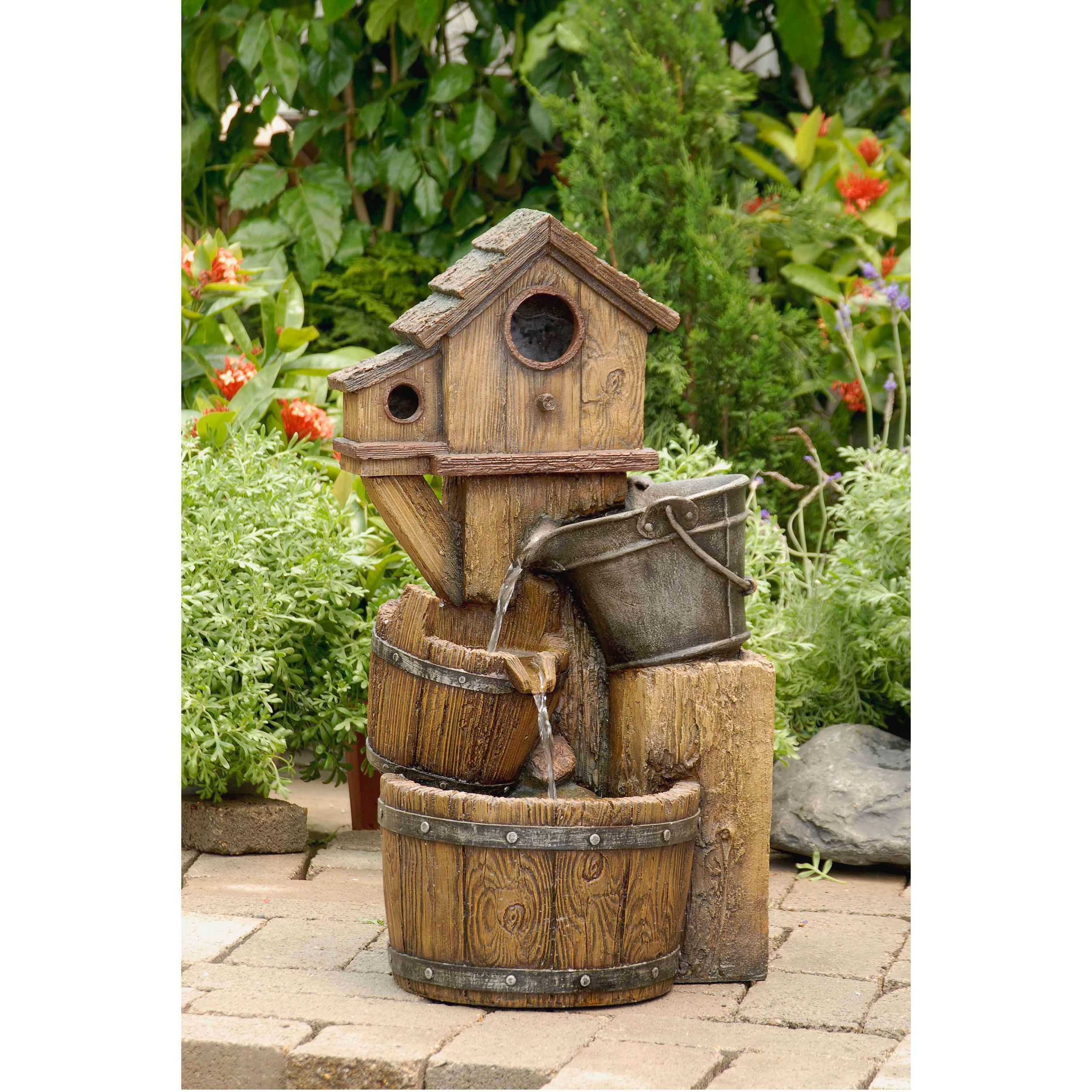 this distressed bird house fountain will add a rustic style to your backyard  water falls from