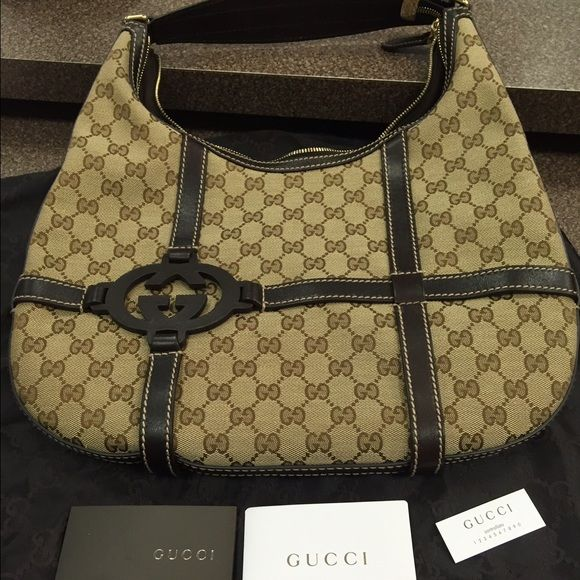 Gucci Royal GG monogram canvas purse This bag is in perfect condition! . Will go with everything and has the GG monogram on it. 14 x 13 x 1.5 in. Gucci Bags Hobos