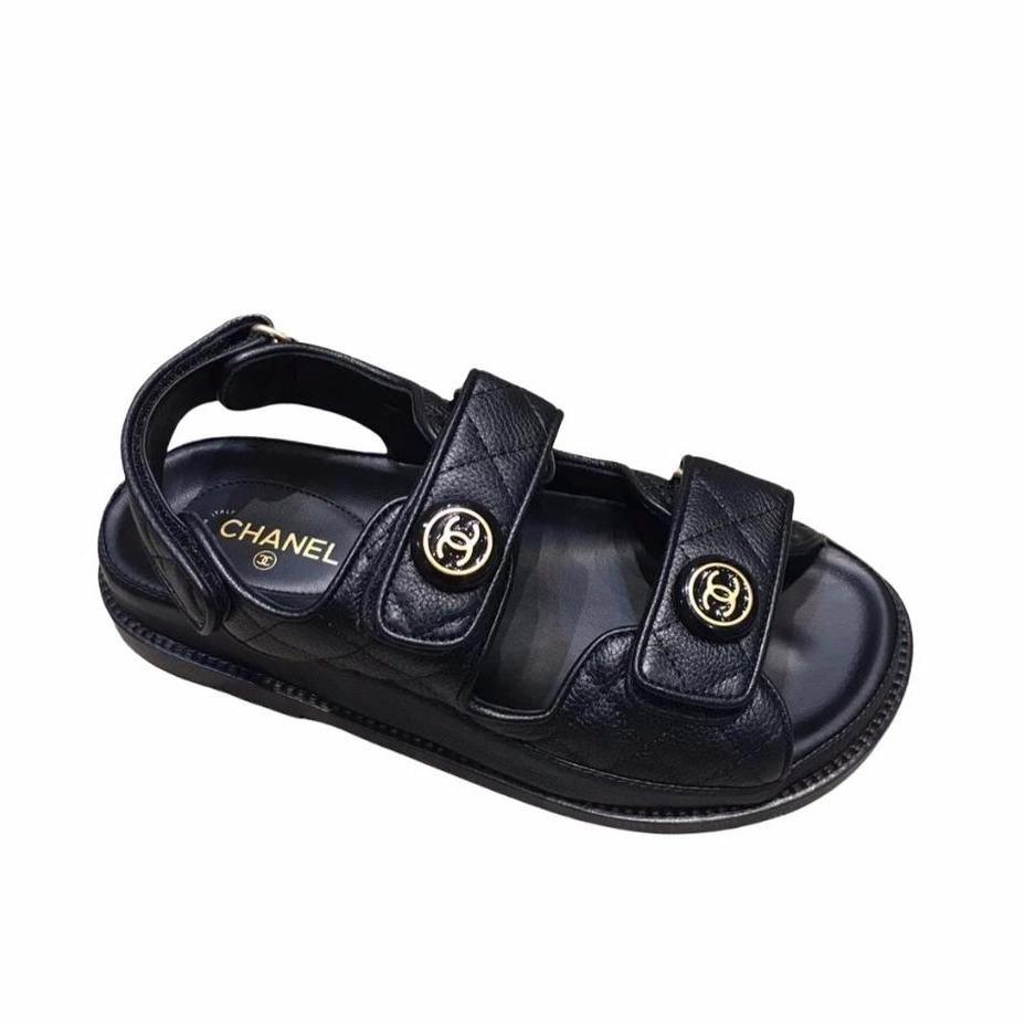 1) CHANEL black leather 'DAD' sandals
