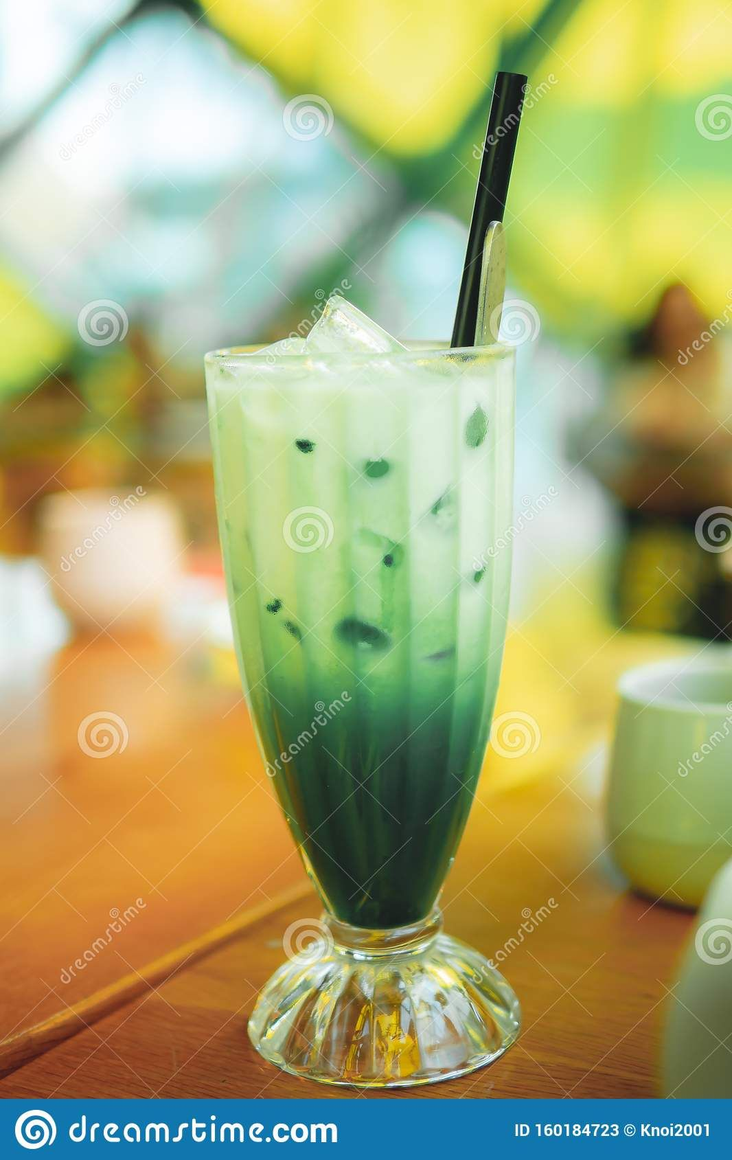 Photo about Iced matcha green tea latte with Milk in tall