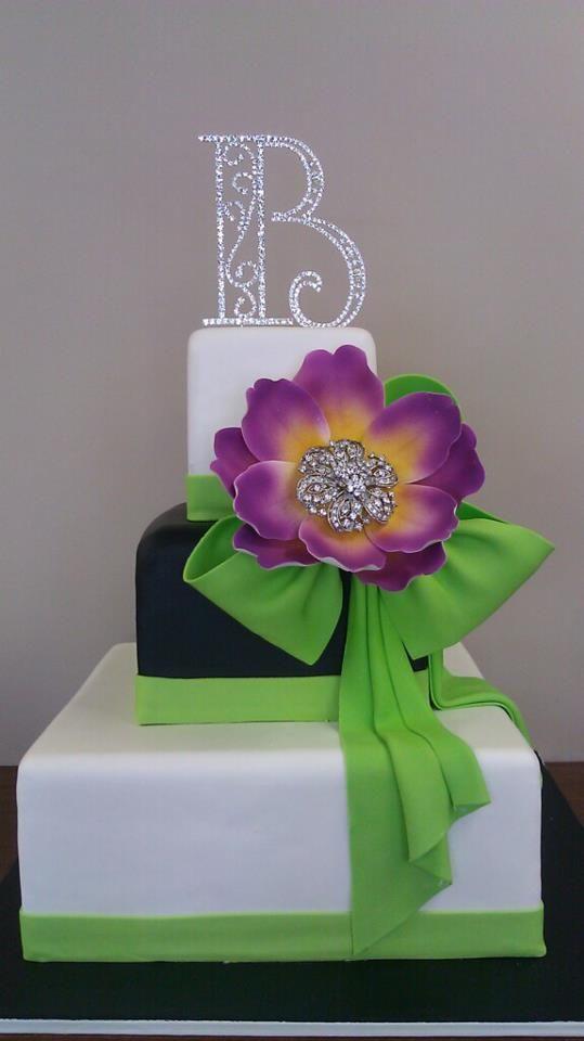 green black purple orange wedding cake