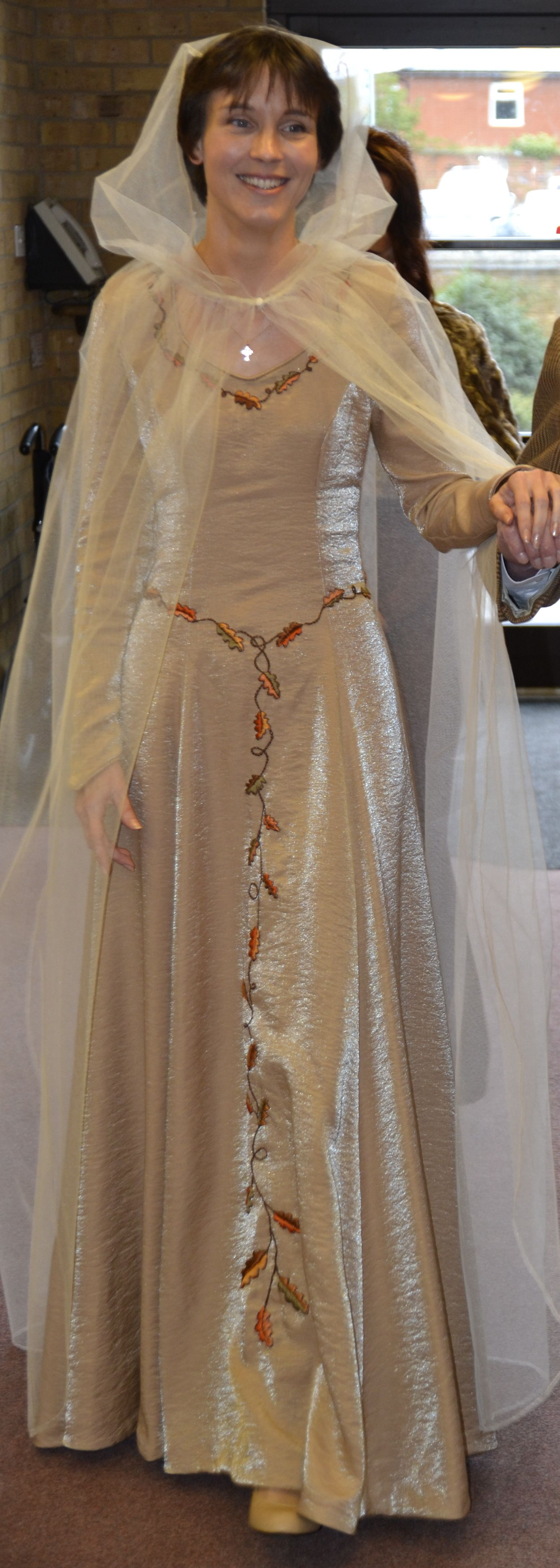 A Medieval style Wedding dress in Gold silk. Hand embroidered with ...