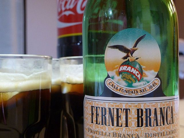 Fernet. 'Fernet is usually served as a digestif after a meal but may also be served with coffee and espresso or mixed into coffee and espresso drinks. In Argentina it is commonly mixed with Coca Cola.' http://www.lonelyplanet.com/argentina