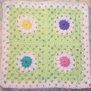 Four Patch Daisy Granny Square | AllFreeCrochetAfghanPatterns.com