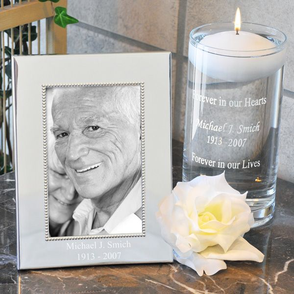 Honor loved ones who are with you in spirit on your wedding day with this floating memory candle and picture frame set engraved with 2 lines of print for your loved one's name and dates.