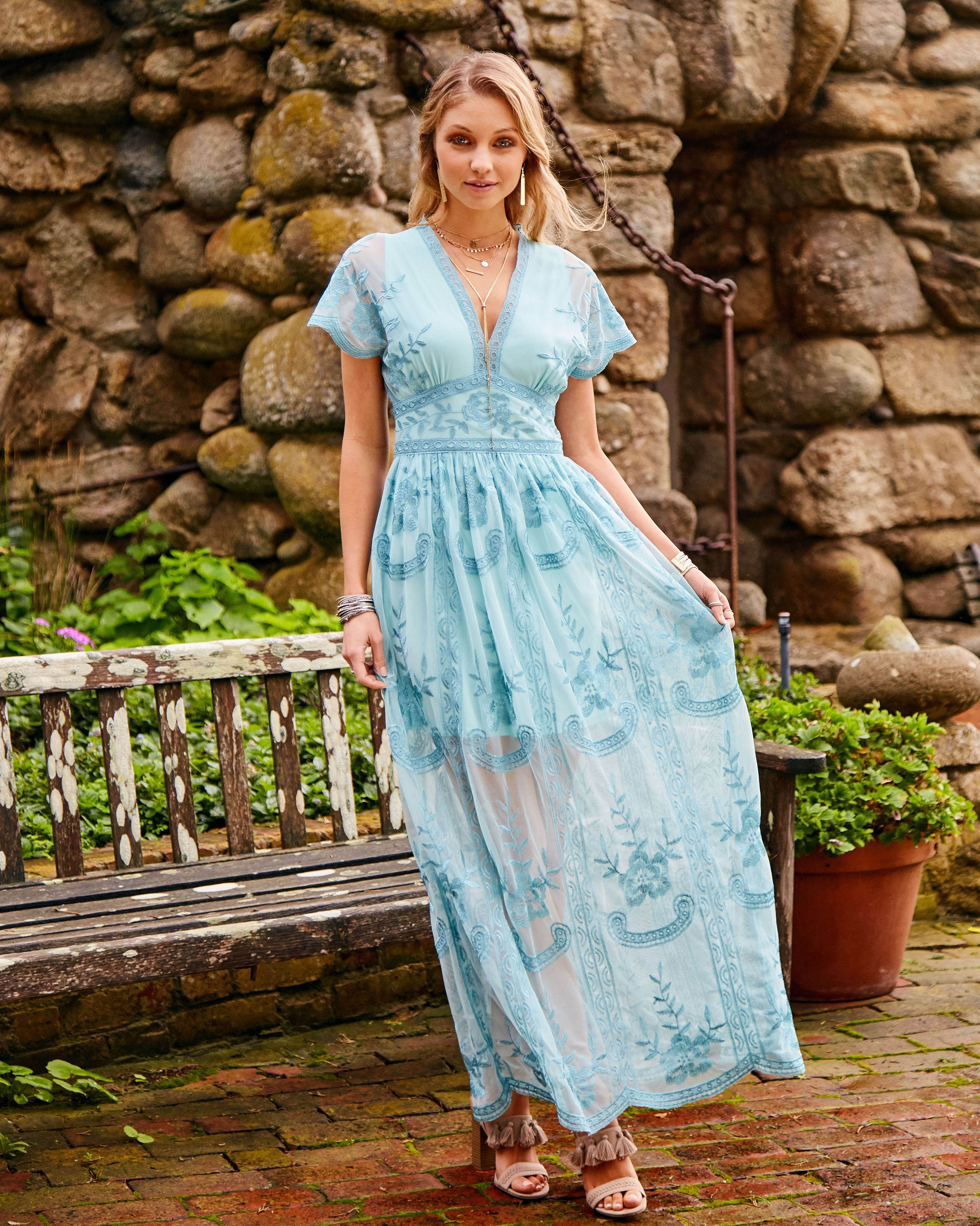 ea8646ee3d1 Turn heads in our elegant Mariska Maxi Dress. This lace embroidered beauty  is great for Spring weddings