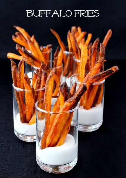 Crispy, oven baked french fries baked in buffalo wing sauce. Great as a low fat snack or side dish!
