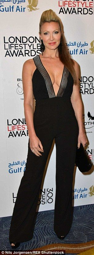 Ready to party: Caprice wowed in a daring jumpsuit with a plunging neckline at the awards ...