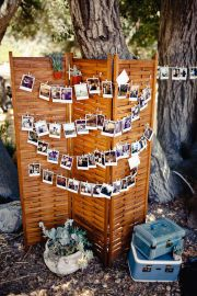 old shutter/door to hang polaroids...perfect!
