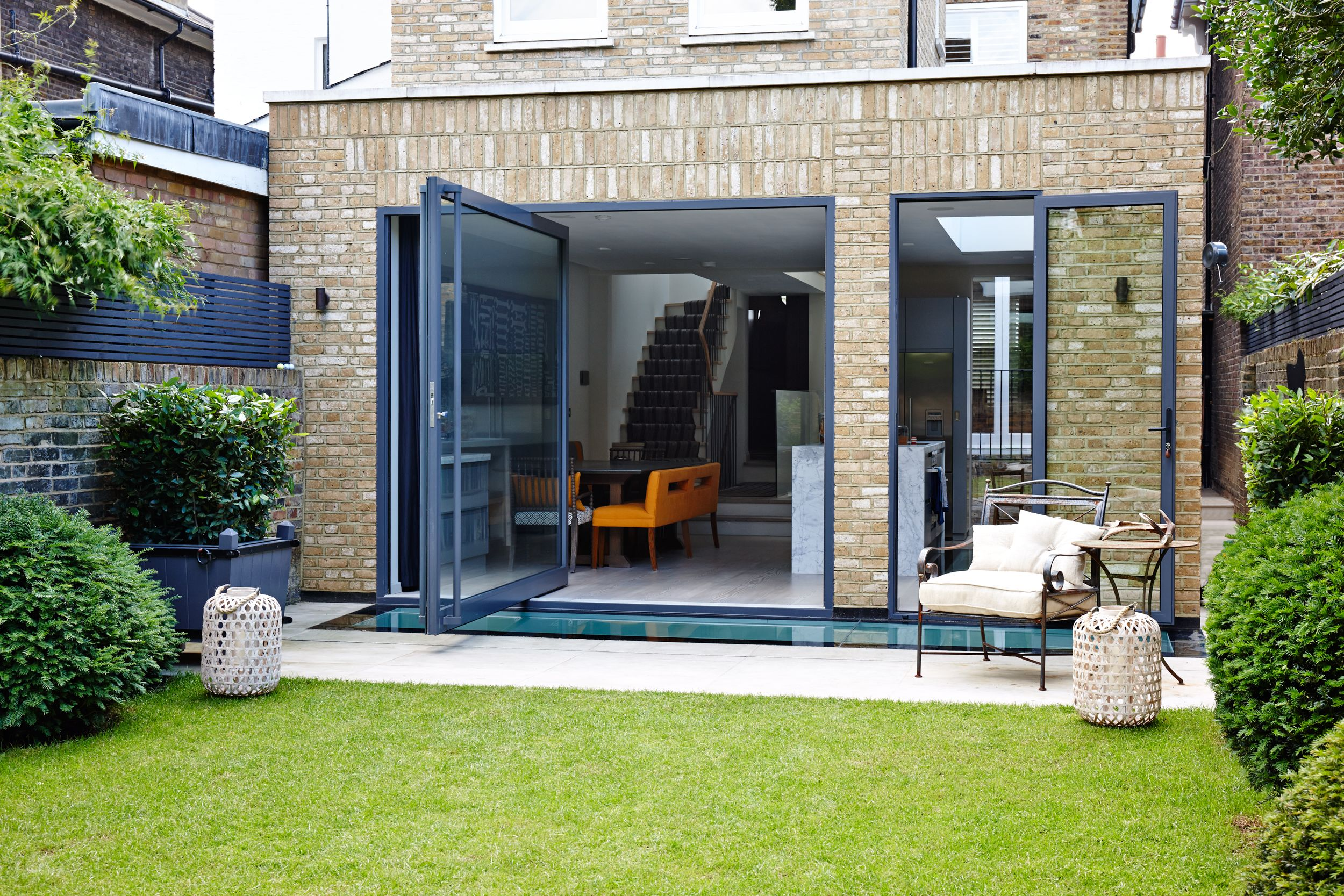 An extension that incorporates an oversized pivot door and a walk on
