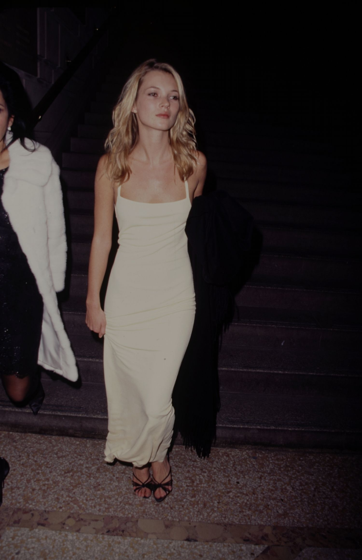 377193dc97a Kate Moss - wearing a simple yellow slip dress at The Met Gala 1995  HarpersBAZAAR.com