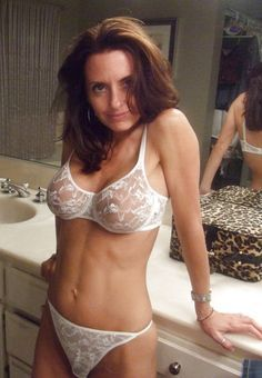 Older woman wearing white lace bra and panties