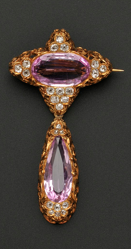 Antique 18kt Gold, Pink Topaz and Diamond Brooch, Retailed by Jones, Ball & Poor, Boston, set with an oval-shape pink topaz with old mine-cut diamond accents, within scrolling foliate mount, suspending a conforming drop, lg. 2 1/8 in., within original fitted box with paper label affixed to underside.