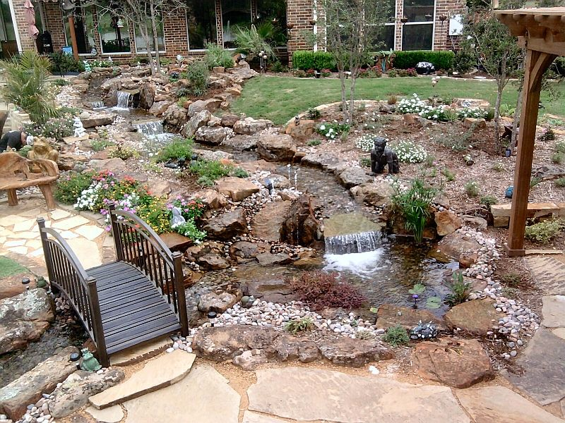 Water garden and patio since it 39 s impossible to grow for Pictures of backyard waterfalls