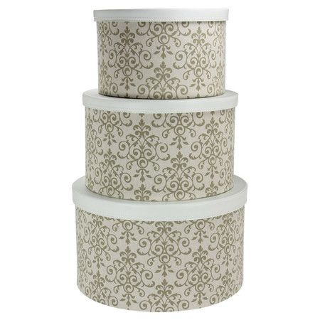 Stow accessories and trinkets in eye-catching style with these delightful hat boxes, featuring a Baroque-inspired scrolling pattern in olive and cream.