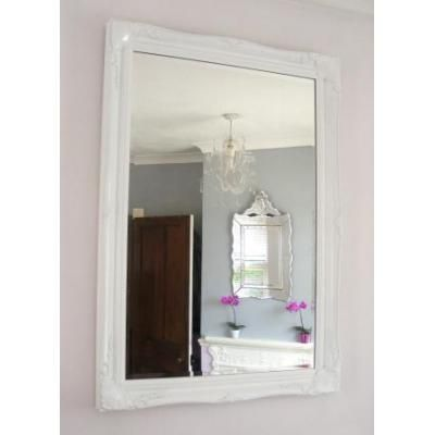 Classically styled overmantle mirror with a french style white frame ...