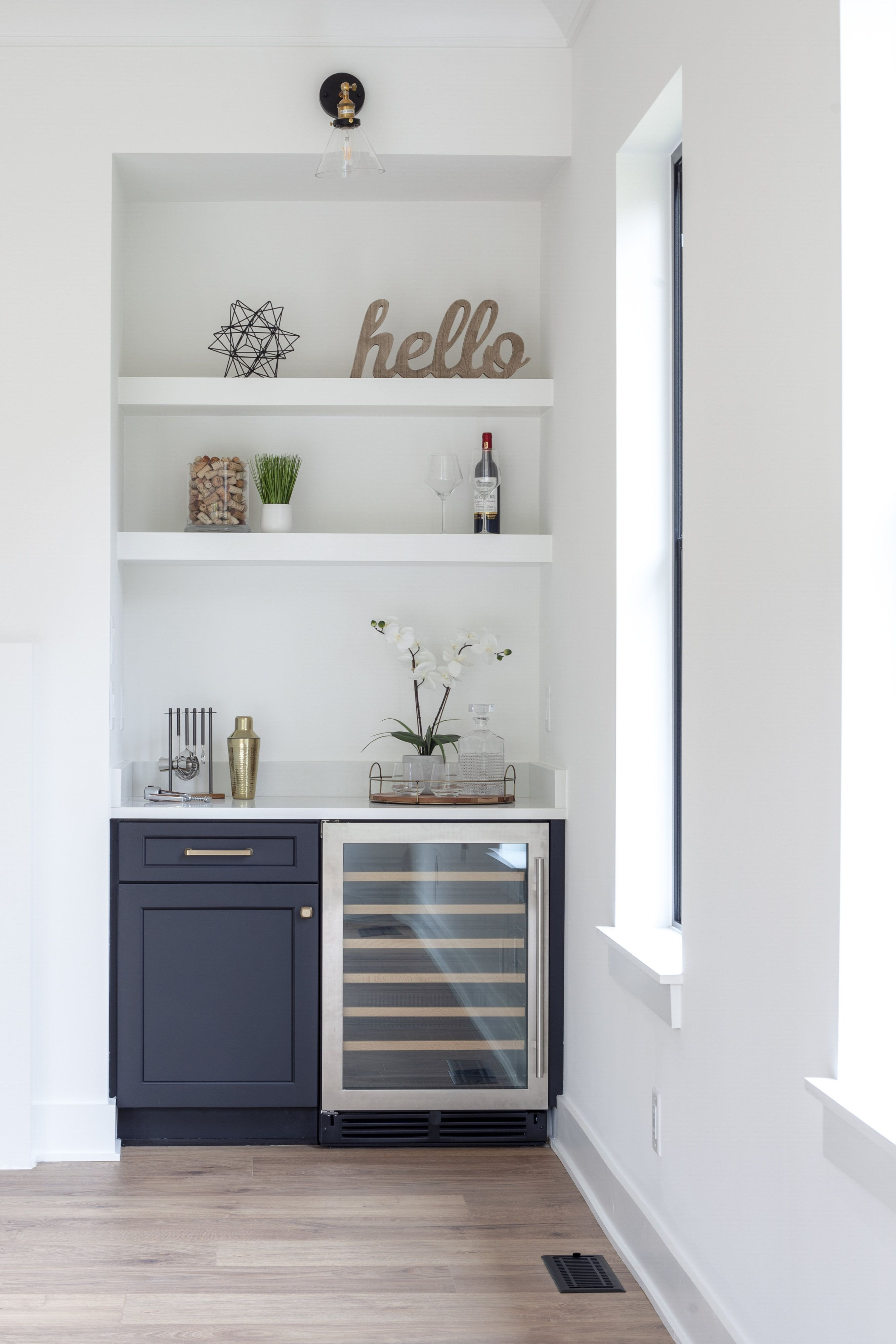 Dry bar in living room with custom and wine fridge