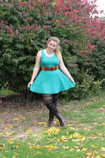 Blue lace dress with black tights and boots