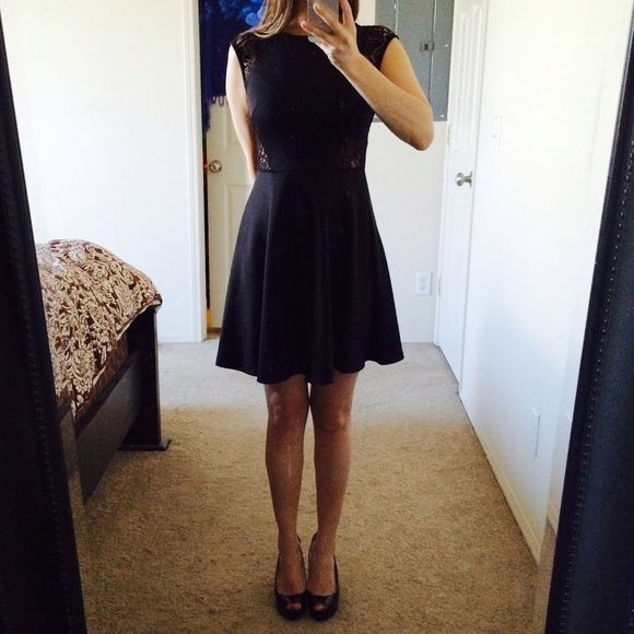 Black dress Black dress with pretty print that is see thru. Small but can be M too. Bar III Dresses
