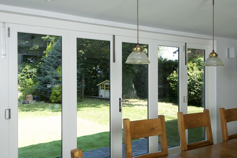 timber bifold doors, external fully open, white, by Mumford & Wood ...