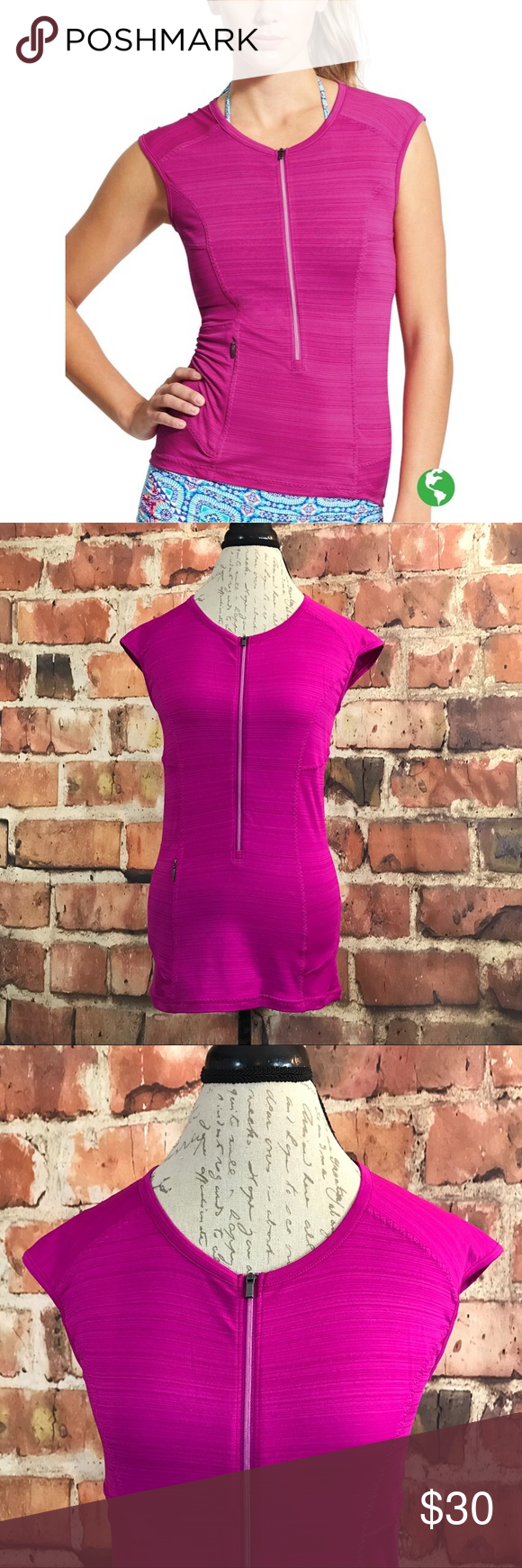 """Athleta Pacifica UPF Tank 3.0 Electric Fuschia M A semi fitted tank that is light & comfy! Features space Dye like detail in an Electric Fuschia color. Features a Zippered pocket and riches like detail on the back along with a Zippered front. Lightly worn once, in New like condition!   Additional Information:  Made in: Vietnam  Material: recycled Polyester/Spandex  Bust: 35""""  Waist: 32""""  Length: 26.5"""" from top center back hem to bottom hem Athleta Tops Tank Tops"""