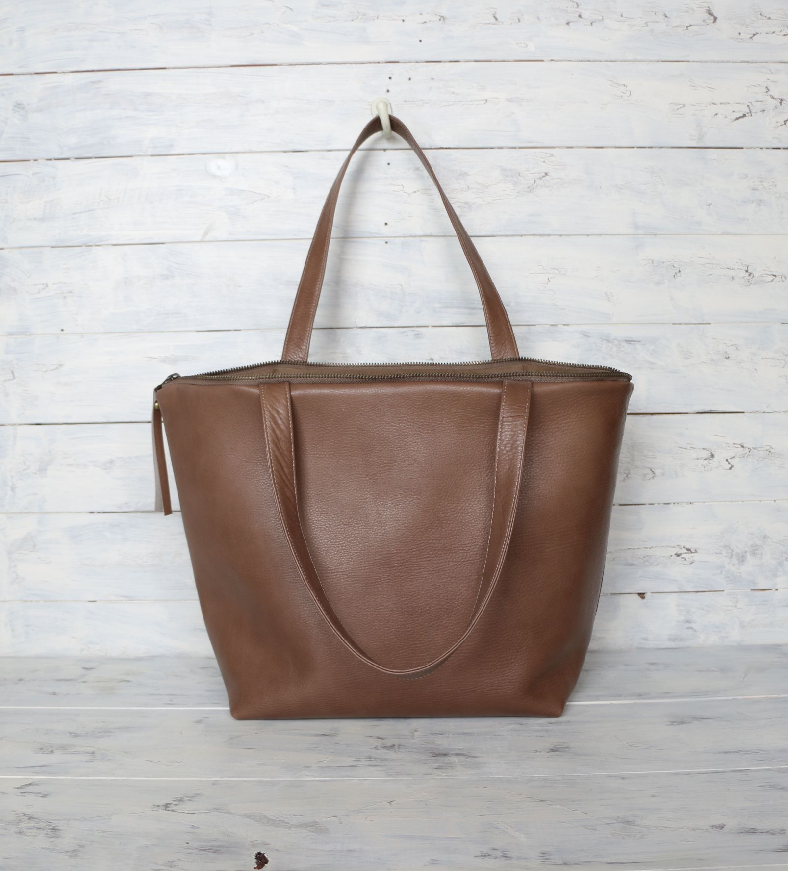 New /// Large size Beautiful Brown Leather Tote Bag  This Leather tote bag is made of Very soft & Supple beautiful Brown Cow Leather . Fully lined with thick Khaki Brown canvas with 4 large open pockets and one small zipper pocket. Top Zipper closure with leather zipper pull. This Beautiful Leather Tote Bag is Roomy enough for all your daily essentials and would work great all year round. The leather handles are strong enough to carry your laptop, Books and fit comfortably over your…