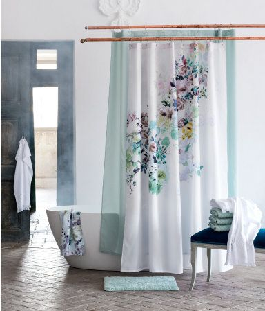 Floral Shower Curtain With A Turquoise Bath Mat H M Home