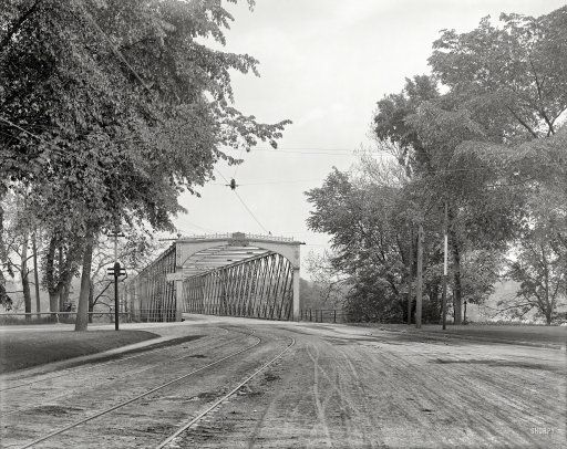"Circa 1908. ""North End bridge, Springfield, Massachusetts."" Points of interest include the signal light on the pole and sign on the bridge. 8x10 inch dry plate glass negative, Detroit Publishing Company."