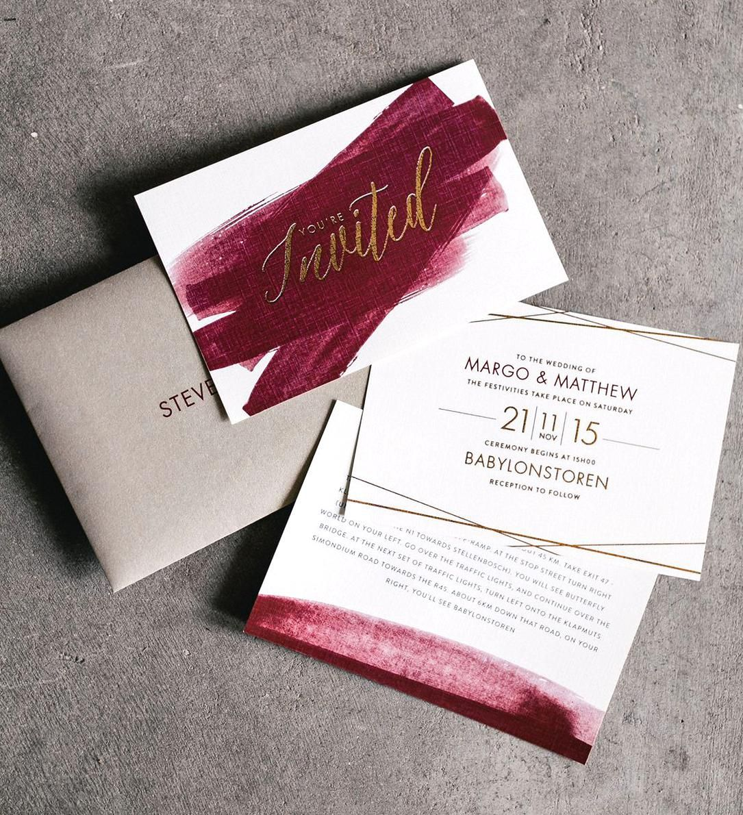 Lezannes Designs gold and maroon wedding stationery in