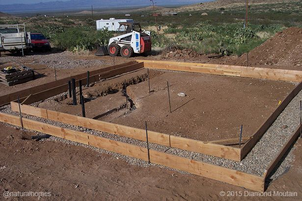 The rubble trench is a cheap and effective foundation that combines drainage with load distribution. The basic principle of it has been around for thousands of years but American architect Frank Lloyd Wright brought it into the 20th century. More at www.naturalhomes.org/permahome/rubble-trench-foundation.htm
