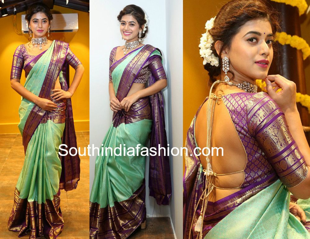 cd0f22f54ad919 ... their collection wearing a mint green Kanchipuram saree that has purple  and gold zari border paired with mathcing elbow length sleeves backless  blouse.