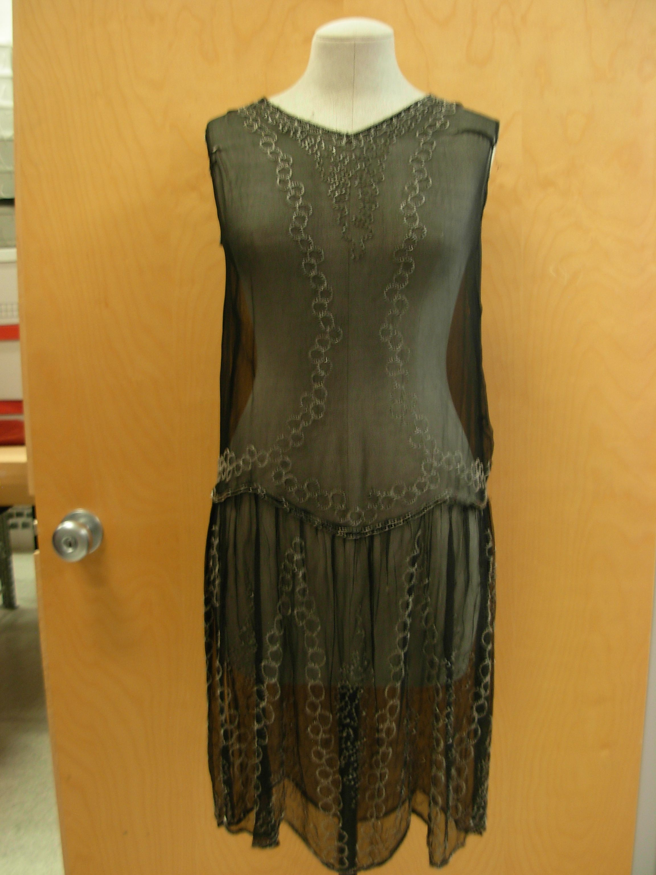 Sheer dress with silver metal ring details.